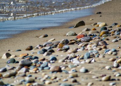 Close Up Colourful Rocks on a Sandy Beach || by AG Fotography